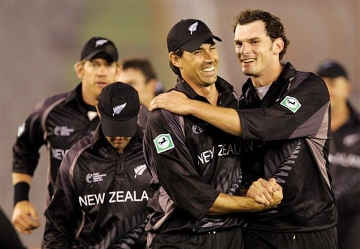 New Zealand's Stephen Fleming, second right, and Kyle Mills, far right, celebrate their victory over Pakistan during the one day international cricket match for the ICC Champions Trophy in Mohali