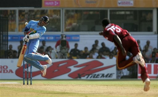 Indian cricket player Sachin Tendulkar is hit by a rising delivery off West Indian bowler Jerome Taylor in Ahmedabad on Thursday.