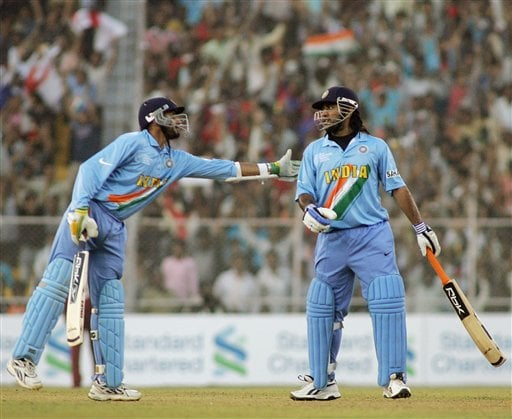 Indian Harbhajan Singh, left, congratulates Mahendra Singh Dhoni during their match against West Indies in the ICC Champions Trophy cricket tournament in Ahmedabad on Thursday.