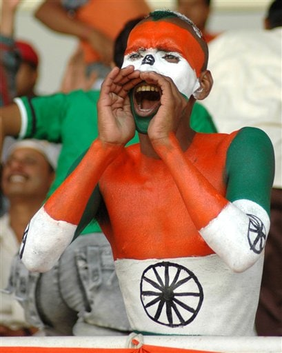 A supporter with his body painted with the Indian tri color cheers the Indian team during the ICC Champions Trophy cricket match against West Indies in Ahmedabad on Thursday.
