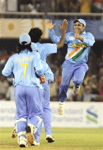 Indian cricket player Virendra Sehwag leaps in the air to celebrate the fall of West Indies' batsman Chris Gayle's wicket during the ICC Champions Trophy cricket tournament match in Ahmedabad on Thursday.