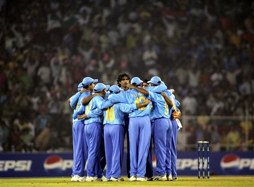 Indian team form a huddle after the dismissal of West Indies' Chris Gayle, unseen, by Munaf Patel, center facing camera, during their match in the ICC Champions Trophy cricket tournament in Ahmedabad on Thursday.