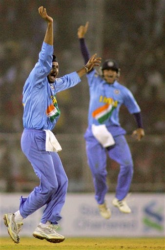 Indian Harbhajan Singh, left, and Suresh Raina celebrate after Singh dismissed West Indies' Dwayne Bravo, unseen, during their match in the ICC Champions Trophy cricket tournament in Ahmedabad on Thursday.