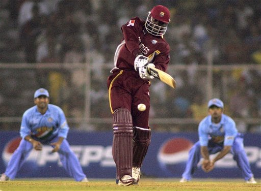 West Indies' Chris Gayle, center, hits a stroke during the ICC Champions Trophy cricket tournament match against India in Ahmedabad on Thursday.