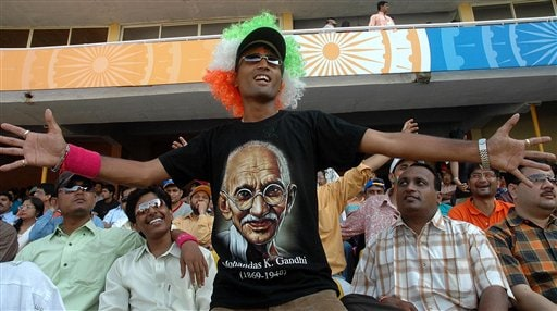 A supporter of the Indian team wearing a T shirt with a picture of Mahatma Gandhi cheers up during the ICC Champions Trophy one day cricket match against West Indies in Ahmedabad on Thursday.