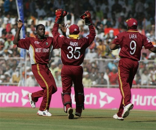 West Indies' Jerome Taylor, left, celebrates with Carlton Baugh Jr., center, and captain Brian Lara after dismissing Indian Virender Sehwag, unseen, during the ICC Champions Trophy cricket tournament match in Ahmedabad on Thursday.