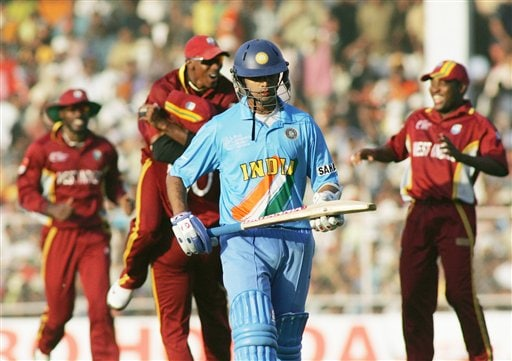 Indian captain Rahul Dravid, center, walks back after being run out as West Indies team members celebrate during the ICC Champions Trophy cricket tournament match in Ahmedabad on Thursday.
