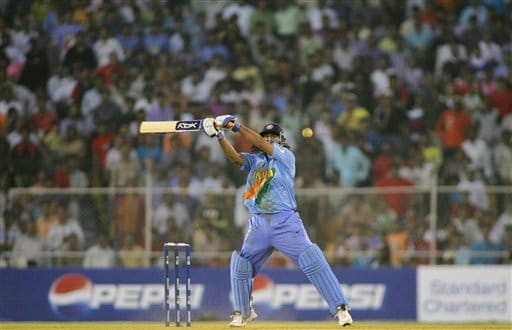 Indian Mahendra Singh Dhoni hits a shot during the match against West Indies in the ICC Champions Trophy cricket tournament in Ahmedabad on Thursday.