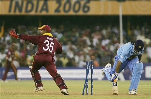 West Indian wicketkeeper Carlton Baugh looks at the umpire for confirmation after running out Indian batsman Mahendra Singh Dhoni during the ICC Champions Trophy cricket tournament match in Ahmedabad on Thursday.