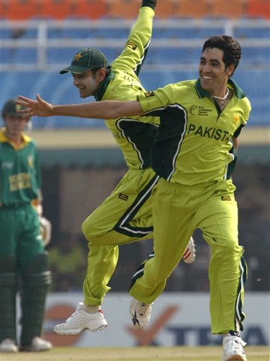 Pakistan's Umar Gul, right, and Muhammad Hafeez celebrate a dismissal of South African Herschelle Gibbs during their one-day international cricket match for the ICC Champions Trophy in Mohali on Friday.