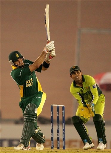 South Africa's Justin Kemp, left, plays a shot as Pakistan's wicketkeeper Kamran Akmal looks on during their one-day international cricket match for the ICC Champions Trophy in Mohali on Friday.