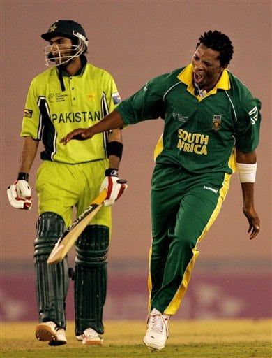 South Africa's Makhaya Ntini, right, celebrates a dismissal of Pakistan's Shoaib Malik, left, during their one-day international cricket match for the ICC Champions Trophy in Mohali on Friday.