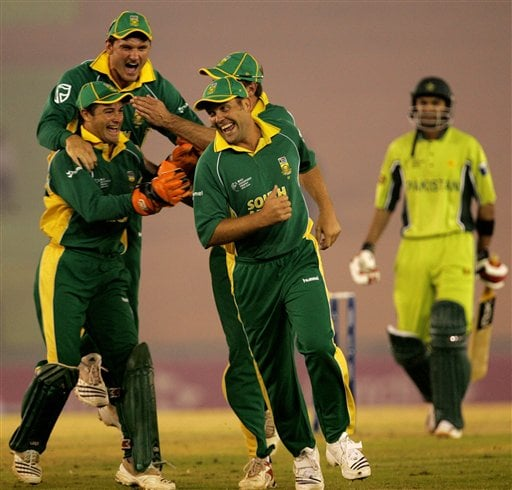 South African cricket players celebrate a dismissal of Pakistan's Shoaib Malik, right, during their one-day international cricket match for the ICC Champions Trophy in Mohali on Friday.