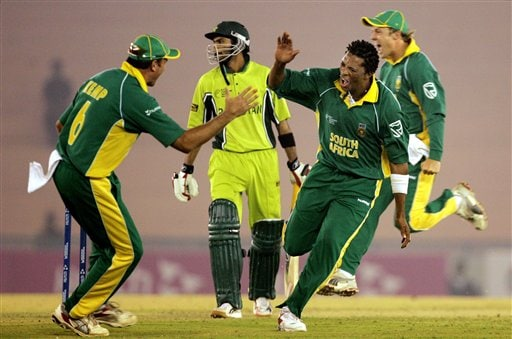 South Africa's Makhaya Ntini, second right celebrates the dismissal of Pakistan's Shoaib Malik, second left, during the one-day international cricket match for the ICC Champions Trophy in Mohali on Friday.