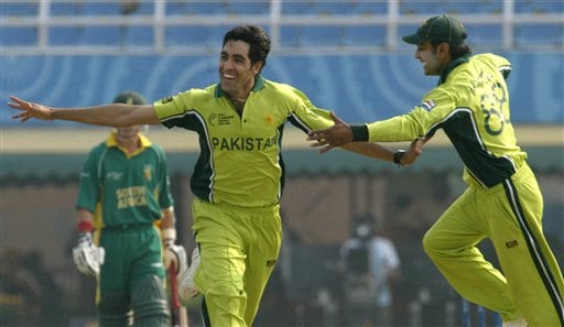 Pakistan's Umar Gul, left, and Muhammad Hafeez celebrate a dismissal of South African Herschelle Gibbs during their one-day international cricket match for the ICC Champions Trophy in Mohali on Friday.