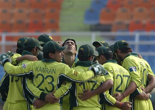 Pakistan's Umar Gul, center, looks up as he huddles together with teammates after the dismissal of South African Captain Graeme Smith, unseen, during their one-day international cricket match for the ICC Champions Trophy in Mohali on Friday.