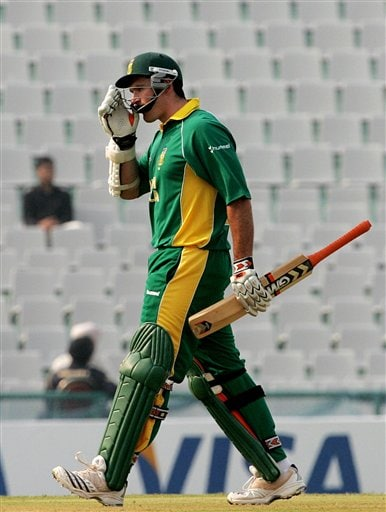South African cricketer Graeme Smith leaves the ground after Pakistan's Umar Gul took his wicket during the one-day international cricket match for the ICC Champions Trophy in Mohali on Friday.