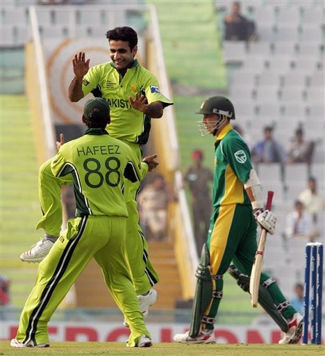 Pakistan's Iftikhar Anjum, without cap, and teammate Mohammad Hafeez celebrate a dismissal of South Africa's Boeta Dippenaar, right, during their one-day international cricket match for the ICC Champions Trophy in Mohali on Friday.