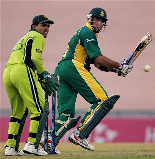 South African cricketer Justin Kemp, right, plays a shot as Pakistan's wicketkeeper Kamran Akmal looks on during the one-day international cricket match against Pakistan for the ICC Champions Trophy in Mohali on Friday.