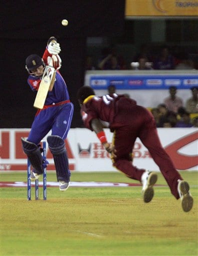 England's Ian Bell, left, ducks away from a ball from West Indies' Fidel Edwards, right, during the ICC Champions Trophy cricket tournament match in Ahmedabad on Saturday.