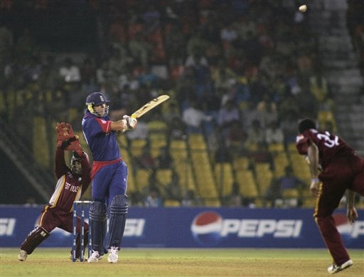 England cricket team batsman Kevin Pietersen hits a four while playing in the ICC Champions Trophy cricket one-day match against West Indies in Ahmedabad on Saturday.