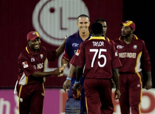 West Indies' captain Brian Lara, left, congratulates Kevin Pietersen, second left, after England won the ICC Champions Trophy cricket tournament match in Ahmedabad on Saturday.