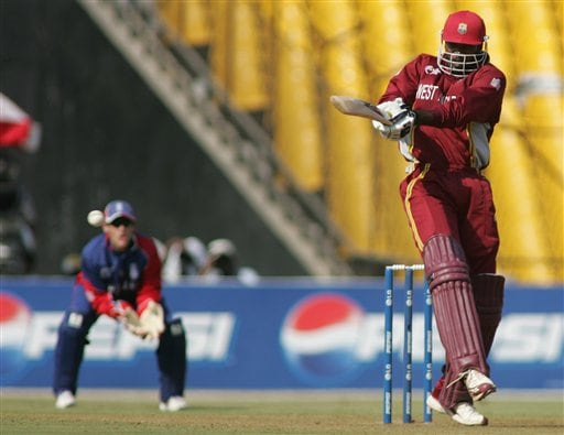 West Indies batsman Chris Gayle hits a four off England bowler James Anderson during their ICC Champions Trophy cricket tournament match in Ahmedabad on Saturday.