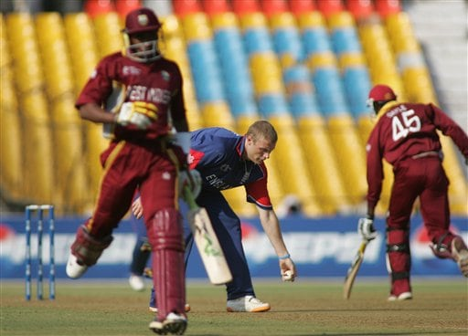 England cricket team captain Andrew Flintoff, center, collects a throw from a fielder as West Indies cricketers take a run during their ICC Champions Trophy cricket tournament match in Ahmedabad on Saturday.