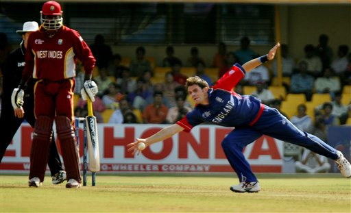 England's James Anderson fields the ball off his own bowling as West Indies' Chris Gayle, left, looks on during their ICC Champions Trophy cricket tournament match in Ahmedabad on Saturday.