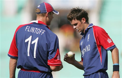 England cricket team captain Andrew Flintoff, left, talks to teammate James Anderson while playing in the ICC Champions Trophy cricket one day match against West Indies in Ahmedabad on Saturday.