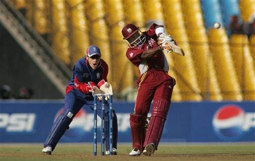 West Indies' Dwayne Bravo hits a four in the fine leg region while playing in the ICC Champions Trophy cricket one-day match against England in Ahmedabad on Saturday.