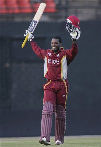 West Indies batsman Chris Gayle raises his bat after scoring a century while playing in the ICC Champions Trophy one-day cricket match against England in Ahmedabad on Saturday.