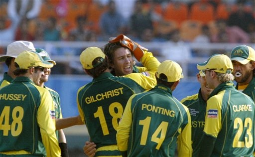 Australia's bowler Glenn McGrath, center, being congratulated by Adam Gilchrist (18) and team mates on the dismissal of India's Sachin Tendulkar, unseen during the one day international cricket match for the ICC Champions Trophy in Mohali on Sunday.