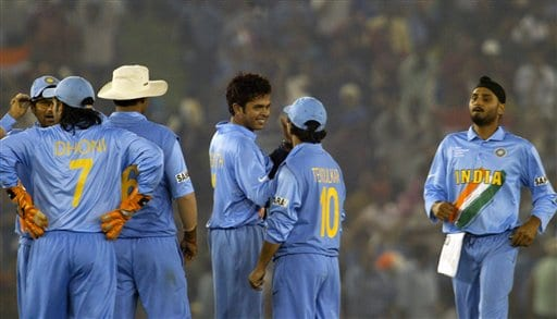 India's bowler Shantakumaran Sreesanth, third right, celebrates with Sachin Tendulkar, (10) and other teammates as Harbhajan Singh, right, joins them after the dismissal of Australia's Adam Gilchrist, useen, during the one day international cricket match for the ICC Champions Trophy in Mohali on Sunday.