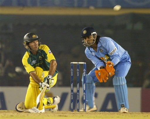Australia captain Ricky Ponting takes a shot as India's wicket keeper Mahendra Singh Dhoni reacts during the one day international cricket match for the ICC Champions Trophy in Mohali on Sunday.
