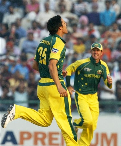 Australia's Mitchell Johnson, left celebrates the dismissal of India's Virender Sehwag, unseen, as captain Ricky Ponting, right joins him during the one day international cricket match for the ICC Champions Trophy in Mohali on Sunday.
