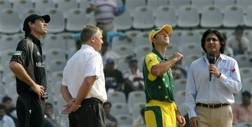Australian cricket Captain Ricky Ponting, second right, tosses a coin as his New Zealand counterpart Stephen Fleming, left, match referee Mike Prokter, second left, and TV anchor Ramiz Raja look on prior to the one-day international cricket match between New Zealand and Australia for the ICC Champions Trophy in Mohali