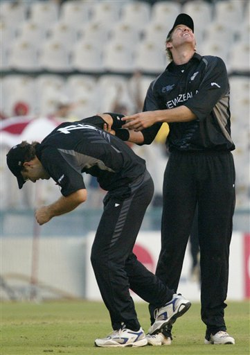 New Zealand's Jacob Oram, right, and Daniel Vettori celebrate the dismissal of Australian captain Ricky Ponting, unseen, during the one day international cricket match for the ICC Champions Trophy in Mohali