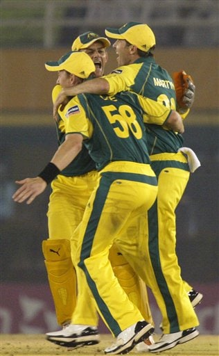 Australian cricketers celebrate the dismissal of New Zealand's Brendon McCullum, unseen, during the one day international cricket semi final match for the ICC Champions Trophy in Mohali