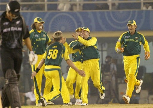 Australia's Michael Hussey runs to Brett Lee (58) as wicket keeper Adam Gilchrist, right, joins the celebration for the dismissal of New Zealand's Nathan Astle, unseen, during the one day international cricket match for the ICC Champions Trophy in Mohali