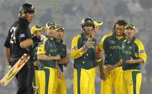 Australian cricketers watch the replay of a run out for New Zealand's Jacob Oram as he walks out to the pavilion during the one day international cricket semi final match for the ICC Champions Trophy in Mohali