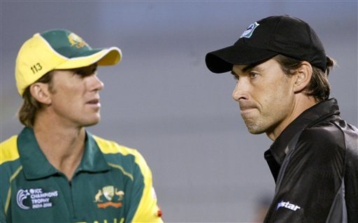 New Zealand captain Stephen Fleming, right, gestures as the man of the match Glenn McGrath of Australia looks on during the one day international cricket semi final match for the ICC Champions Trophy in Mohali