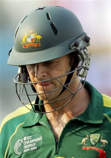 Australia's Adam Gilchrist leaves the ground after New Zealand's Kyle Mills, unseen, took his wicket during the one-day international cricket match for the ICC Champions Trophy in Mohali