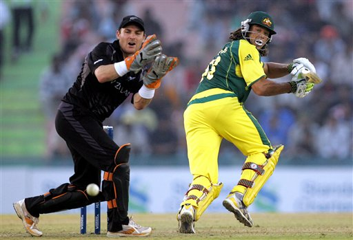 Australia's Andrew Symonds, right, plays a shot as New Zealand's wicket keeper Brendon McCullum looks on during the one day international cricket semi-final match for the ICC Champions Trophy in Mohali