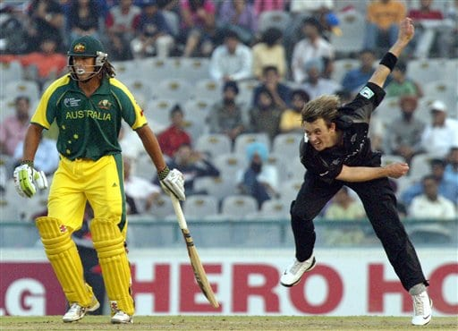 New Zealand's Shane Bond bowls, right, as Australian batsman Andrew Symonds waits to take a run during the one day international cricket semi final match for the ICC Champions Trophy in Mohali