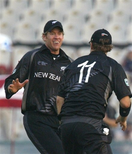 New Zealand's Jacob Oram, left, congratulates teammate Daniel Vettori (11) after the later took a catch to dismiss Australian captain Ricky Ponting, unseen, during the one day international cricket semi final match for the ICC Champions Trophy in Mohali