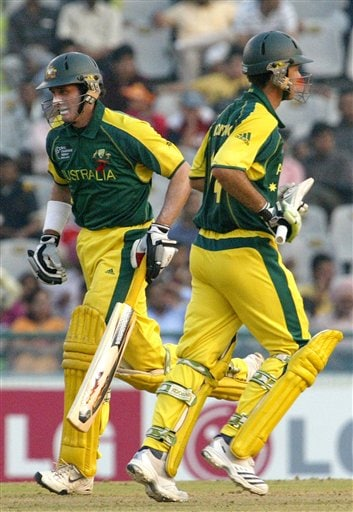 Australia's Michael Hussey, left, and captain Ricky Ponting run between the wickets during the one day international cricket semi-final match against New Zealand for the ICC Champions Trophy in Mohali
