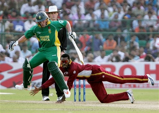 South African batsman Abraham Devilliers, left, jumps as West Indies' Chris Gayle tries to field off his own bowling in the second semi-final of the ICC Trophy cricket tournament in Jaipur