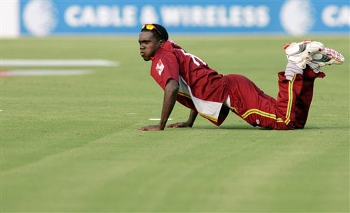West Indies' Jerome Taylor follows the ball after failing to stop it from a boundary during the ICC Champions Trophy cricket tournament match against South Africa in Jaipur