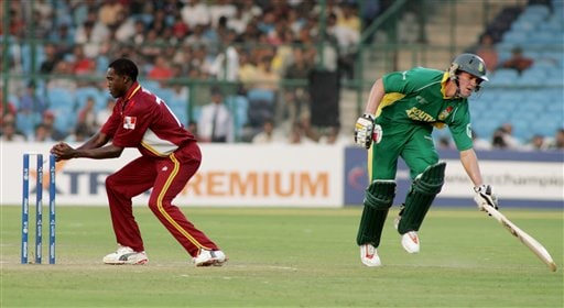 South African AB de Villiers, right, finishes a successful run as West Indies' Jerome Taylor knocks his bails during the ICC Champions Trophy cricket tournament match against West Indies in Jaipur